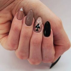 Rose-gold makes a good base for black. And if you want to take it a step further, try it with geometric shapes and patterns. | 16 Ideas For Black Nail Polish That You'll Love If You Have A Cold, Black Heart