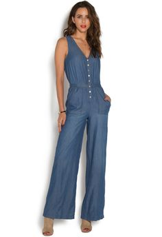 When denim on denim just isn?t enough, go with this chambray jumpsuit by JustFab. This comfortably chic style features a cinched waist and flared pant that's fl