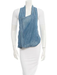 Blue Helmut Lang denim vest with metallic zip pockets at and zip closure at front.