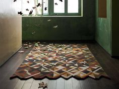 The Lattice Rug is part of the GAN Hand Tufted Collection and features a unique and contemporary design.