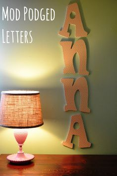 DIY: Mod Podge and Wooden Letters: A great way to add a custom look to your letters.