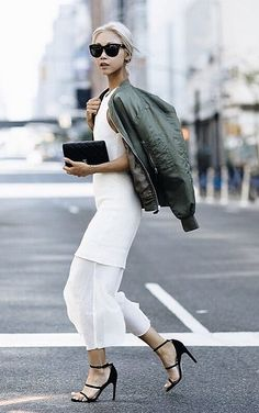 Vanessa Hong of the Haute Pursuit wears a white dress, bomber jacket, strappy heels, and black accessories / outfits to impress / fashion / street style / outfit / stylish Army Jacket Outfits, Bomber Jacket Outfit, Jacket Dress, Sporty Chic, Look Fashion, Womens Fashion, Fashion Trends, Dress Over Pants, Outfits