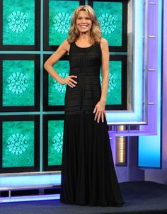 """J S COLLECTIONS: Black illusion gown w/multi-directional satin """"stripes"""", round neckline, sleeveless, drop skirt in illusion over jersey 