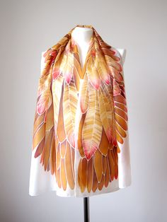 Gold Feathers on silk scarf! Hand painted spread wings in golden and red inspired by Aztec Art. #minkulul