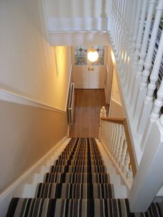 designer striped stair carpet provides contemporary interior to victorian house