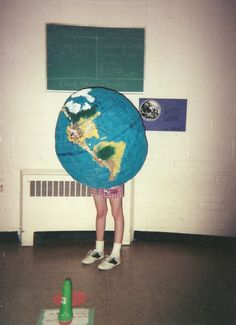 """""""My class we had to do a project where we were a living museum. Somehow, my 'exhibit' was the Earth itself. This was the end result, and I'm so proud of this picture I have it framed in my apartment to confuse guests."""" (submitted by Katie)"""