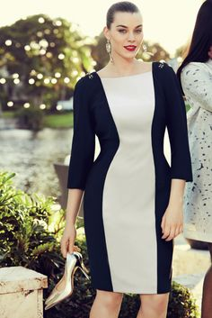 Fitted knee length dress in comfort triacetate with long sleeves and contrasting sculpted panel running neckline to hem. The neckline sits square at the front and in a deep V at the back with hand sewn jewel detail on the shoulders. The dress is fully lined.
