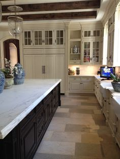 Kitchen: white marble counter tops - white cabinets
