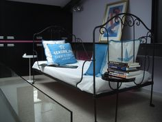 Original French day bed, made of wrought iron.  It folds flat, often referred to as Napoleon camp beds, as they were carried during wars in France. See it at the LuxLoft vacation rental apartment. Liepaja, Latvia