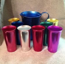 My father always drank buttermilk with crumbled cornbread from one of these! Vintage Set Of 8 Colorful Aluminum Cups And Pitcher Made By West Bend Vintage Colors, Vintage Love, Vintage Images, Retro Vintage, Vintage Items, Vintage Stuff, Vintage Dishes, Vintage Kitchen, Vintage Jars