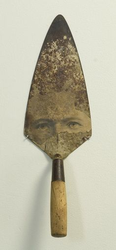 'Dad' (2008) by American collage & assemblage artist James Michael Starr. Steel & wood trowel, photographic print, 16 x 5 x 4 in.