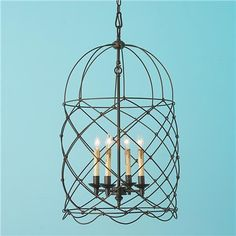 """Circus Wire Cage Lantern Inspired by the popular harlequin design this blackened bronze wire lantern is large in size but light in look.   31""""Hx18.5""""W.  $699"""