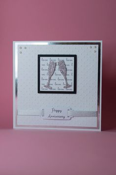 Handmade Anniversary Card with Silver glitter champagne flutes with Love background and Silver ribbon tag Card Size: 6″x 6″ Blank Inside