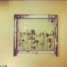 Dried flowers from wedding bouquet in an old window!