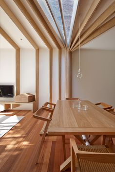 Wooden beams create sewing-inspired details at Cross-Stitch House
