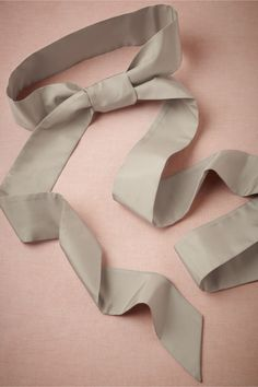 Simply Silk Sash    We love these supple 100% silk sashes from Hitherto. Personalize your dress by adding a brooch, or put its length to use and fix a generous bow. Self-tie. Silk. Imported.