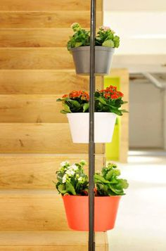 Called Twinnz, this magnetic twin flowerpot system for glass panels gives the illusion of flower pots floating on air.