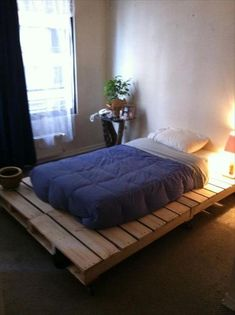 Pallet furniture bed frame. Almost exactly how I want it to look.