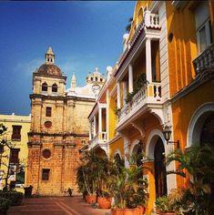 San Pedro Claver Church in front of a Republican building. Cartagena, Colombia