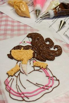 How to transfer a buttercream image onto a cake after piping onto baking paper tutorial - this one is of Dora
