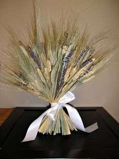 could continue the bearded wheat & lavender from the ceremony to the reception centerpieces