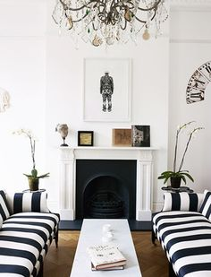 Striped sofas and art in living room.