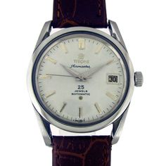 TITONI AIR MASTER DATE AUTOMATIC WATCH  Feature : Center Second, Date, Water Proof, Engrave on Back Cover and Automatic Dial Features : Repainted Dial Dial Color : White Markers : Steel Arrow Figures Case Material : Standard Stainless Steel Case Crown : Pull Band Type : Leather Hands : Steel Hands Movement : Automatic Gender : Gents Machine No. : 2452 Back No. : 307-345 Serial No. : - Jewels : 25  Case Diameter Size : 3.5 cm Side To Side Size : 3.7 cm (Including Crown)
