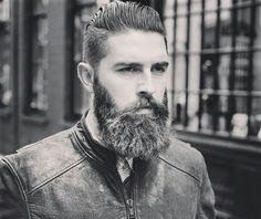 Chris John Millington wears a leather jacket and an outstanding beard. What a fellow!