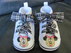 WELCOME TO BUTTERCUP CUSTOMS!  Custom One-Of-A-Kind hand painted shoes Thanks for looking at my hand painted Infant Minnie Mouse shoes. They have hand painted Minnie mouse faces on the front and smaller Minnies on the sides. I can do different ribbons as well (pink, polka dots, red, etc.) These are perfect with a Minnie Mouse dress, shirt or birthday outfit! I can also do Mickey Mouse! They make a wonderful one-of-a-kind gift!  I can do other character shoes as well, if you dont see what you…