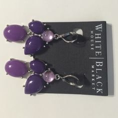 Purple earnings from White House Black Market Gorgeous pair of purple earrings worn only once . I have a matching belt too also from WHBM in case you want to get matching accessories . I wore this with a black polka dot dress at a wedding once - looked fantastic. The belt has to be bought separately if interested . White House Black Market Jewelry Earrings