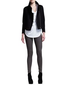 black jacket, white top, gray pants