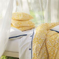 Marni Duvet  If the perfect shade of yellow exists, we think this might be it. Paired with our clean-lined white medallion print, Marni adds just the right punch of color and contrast. White fabric-covered buttons.