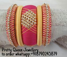 Designer handmade silk thread bangles.. Colours can b customized as per ur choice.. Orders undertaken... Wholesale and resellers r welcome.. To order whatsapp:+918790245879 For more designs visit my page &like it... https://m.facebook.com/whatagirlwants66/