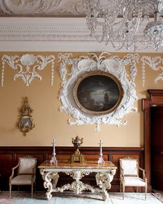 Drawing Room of Russborough Irish home ~ The George II console in the drawing room is flanked by a pair of 1794 chairs, the plasterwork is Baroque, and the 18th-century seascape is one of a quartet by Claude-Joseph Vernet.