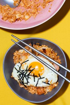 Not the high-heat stir-fry you might expect, Grace Lee's home-style fried-rice recipe uses a simple technique — make an easy, flavorful kimchi sauce, mellowed out with butter, and sauté leftover rice in it. It's perfect for a snack or a quick, simple meal. (Photo: Davide Luciano for The New York Times)