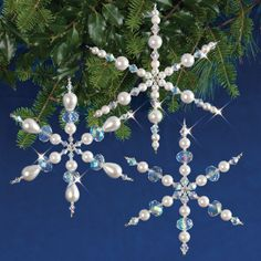 Sparkling Snowflakes: created with creamy satin glass pearls, faceted crystals and silver coloured metal beads and wire. Each kit makes 3 snowflakes, 1 each of three designs.