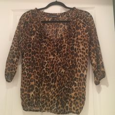 Express dress top Express Brown Leopard print top. Size small. 100% polyester. 3/4 sleeve. Pleating with frayed fabric going down the middle. Top is slightly see-through. In excellent condition. Express Tops Blouses
