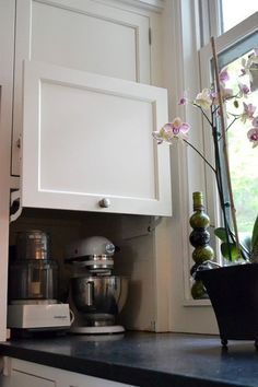 Appliance storage on the worktop but enclosed! Brill. #traditionalkitchens