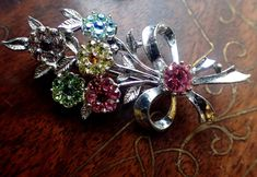 A personal favourite from my Etsy shop https://www.etsy.com/au/listing/587906342/vintage-brooch-crystal-brooch-flower