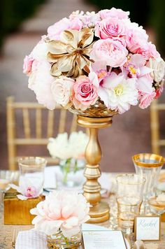 A gilded flower adds glamour to a centerpiece of pink and white peonies and…
