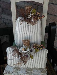 Pumpkin pillows with burlap flowers.
