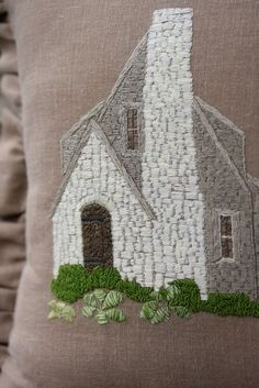 take a photo of your house, change it to black and white in photoshop, print it out on Transfer-Eeze, and stitched it to fabric to make a pillow.