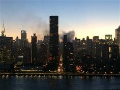 In this mobile phone photo provided by Cat Chung, smoke rises from a fire at a building near Manhattan's Rockefeller Center on Friday, June 6, 2014 as seen from Long Island City in the Queens borough of New York. (AP Photo/Cat Chung) ▼7Jun2014AP|Restaurant near Rockefeller Center catches fire http://bigstory.ap.org/article/restaurant-near-rockefeller-center-catches-fire #New_York_City