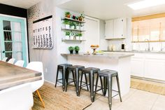 Light and bright kitchen and living room redo on Classy Clutter. Love love the plant shelves, big calendar and gorgeous table!