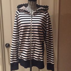 Lululemon athletica sweatshirt Authentic lululemon black and white striped sweatshirt, with a zipper vent down the back and thumb holes. Excellent condition. Please no trades lululemon athletica Tops Sweatshirts & Hoodies