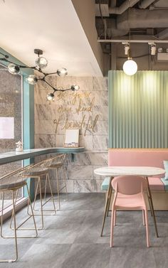 The pastel cafe is tailored to give its customers a fairytale like experience, attracting anyone who is seeking to spend some time in a light and airy atmosphere. The pastel colour scheme of pinks, greens, and neutrals perfectly compliments the marble textured murals used to give the whole space a luxurious castle feel. This beautiful space was accomplished by using the mural marble prints from MuralsWallpaper. #wallpaper #murals #wallmurals #interior #design #homedecor #decor #accentwall