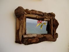 Recycled driftwood mirror frames - so cute :)