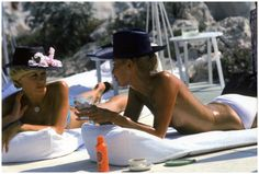 """Sunbathing at the Hotel du Cap Eden Roc, Antibes, France, August 1976 - photo by Slim Aarons.  Aarons made his career """"photographing attractive people doing attractive things in attractive places."""""""