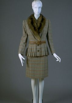 This is a Valentino suit from 1988. During the 80s, as women began to progress in the workforce, the power suit was a popular look, used to convey professionalism and competence. This suit is part of the Philadelphia Museum of Art's collection.