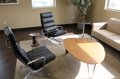 Our Eames Lounge Meeting Space - a comfy, classy place to have a casual or formal sit down.